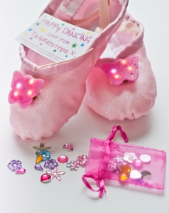 Dressing up sparkly light up ballet shoes for kids that love to dance.